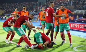 Morocco's Youssef En-Nesyri kneels in prayer after scoring the only goal of the game in Cairo.