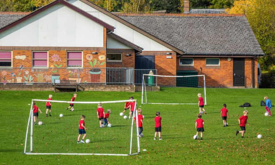 Football practice on a school sports field.
