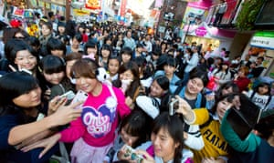 Ai Haruna surrounded by fans in Harajuku, a street popular with teenagers in Tokyo. LGBT rainbow