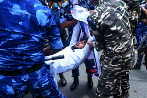New Delhi, India: Congress party workers are detained by security personnel as they take part in a demonstration against the government and prime minister Narendra Modi over alleged surveillance operations using Pegasus spyware