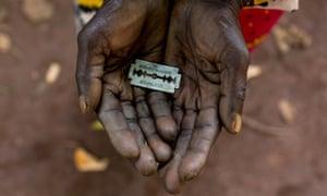 A razor blade held in hands