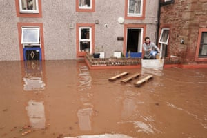 A resident attempts to limit the flood damage as Storm Ciara hits the town of Appleby-in-Westmorland.