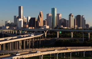 Elevated highways in front of the Houston skyline. Bayous pass underneath, creating freeways for the city's cyclists.