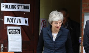 Theresa May leaves after casting her vote on Thursday.