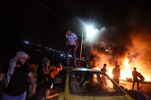 Palestinian demonstrators burn tyres during confrontations with Israeli security forces following a rally in support of Palestinian prisoners held in Israeli jails.