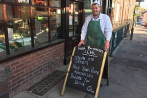 'Have your rump tenderized' … butcher Pete Lymer, who has been told to tone down his signs.