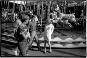People gather at a fairground. Taken from Looking for Love 1978-2003