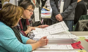Ballots are examined in Michigan before a judge's ruling effectively ended the recount there.