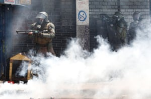 Valparaiso, ChileSecurity forces take position during a protest against Chile's state economic model