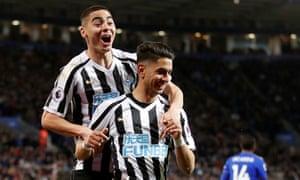 Ayoze Pérez (front) celebrates scoring Newcastle's winner at Leicester with Miguel Almirón.