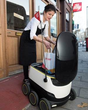 The robot collects its first delivery from Taksim Meze restaurant.