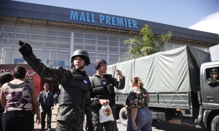 Soldiers stand guard outside a shopping mall in Tegucigalpa, Honduras, on Saturday.