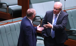 Scott Morrison and Anthony Albanese speak during voting in the House of Representatives on Tuesday.