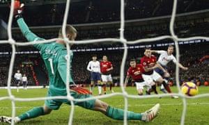Manchester United goalkeeper David de Gea saves a shot from Tottenham's Harry Kane.