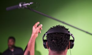 Listening through headphones in a recording studio