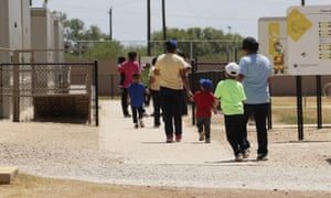 Immigrants seeking asylum at an ICE residential centre in Texas. A US judge has ruled children held with their parents in immigration jails must be released.