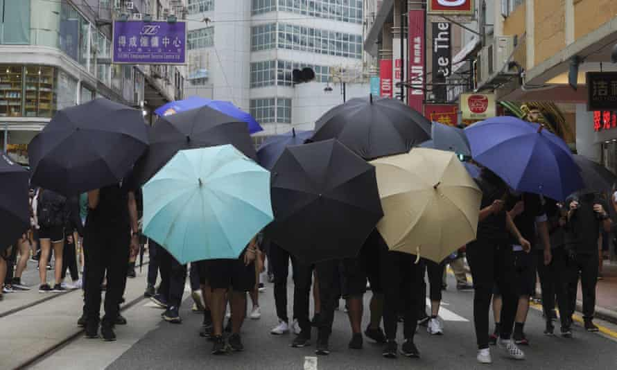Protesters form a shield with umbrellas during a protest against the Chinese national security law in Hong Kong in July.