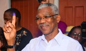 Guyana's new president David Granger displays his inked finger after voting.