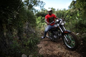 A man rides a motorbike