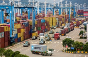 Lines of trucks at a container terminal of Ningbo Zhoushan port in Zhejiang province, China
