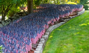 More than 8,000 flags, representing the number of Covid-19 deaths in Massachusetts, in the yard of Mike Labbe in Grafton, Massachusetts.