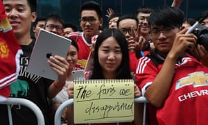 Manchester United fans show their feelings after the pre-season friendly against Manchester City in Beijing was called off due to the state of the pitch