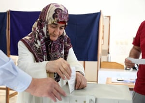 A Turkish Cypriot woman casts her vote during the European elections in Nicosia, Cyprus, 26 May 2019; Turkish Cypriot citizens crossed into the government-controlled areas of the Republic of Cyprus to vote at the European Parliament elections.