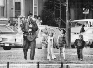 A policeman in Regent Park looks for two suspects in a shooting on 12 June 1975. The area was notorious for crime.