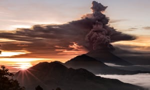 Mount Agung volcano is seen spewing smoke and ash in Bali on Sunday.
