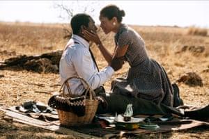 Harris alongside Idris Elba in Mandela: Long Walk to Freedom.