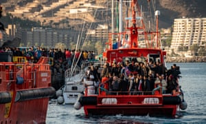 People arrive at the overcrowded port of Arguineguín, Gran Canaria