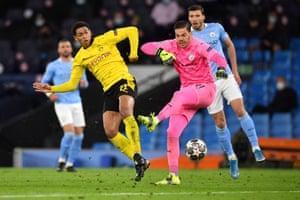Dortmund's English midfielder Jude Bellingham robs Manchester City's Brazilian goalkeeper Ederson, but is ruled to have fouled Ederson.