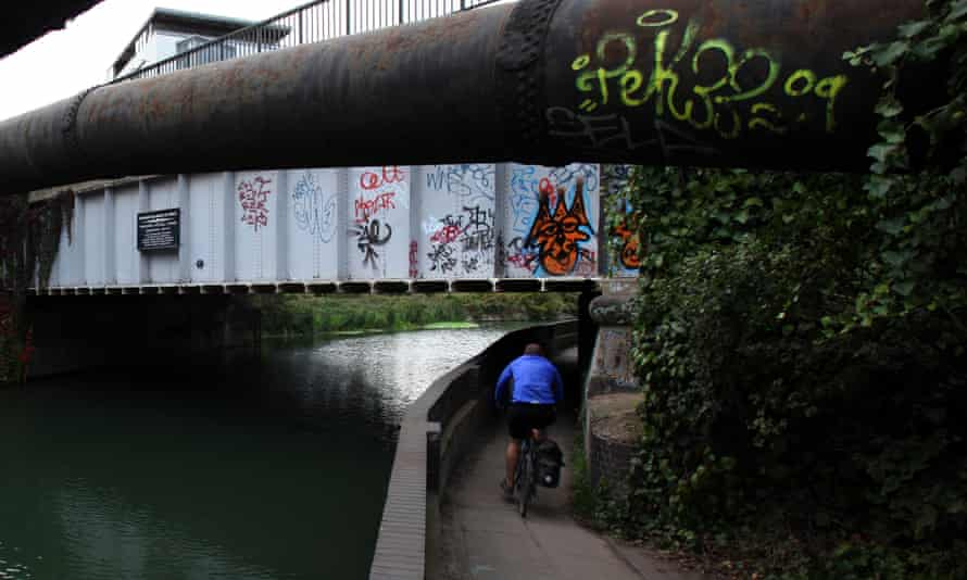 A cyclist on a towpath in London