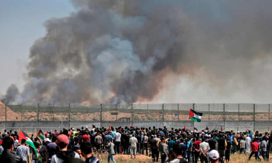 Palestinian protesters near the border fence east of Gaza City