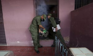 A Cuban military reservist fumigates inside a home in Havana on 22 February, 2016.