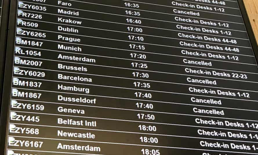 Departure board at Bristol airport shows flybmi flights cancelled following the collapse of the airline
