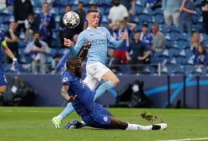 manchester city's phil foden is denied by chelsea's antonio rudiger.