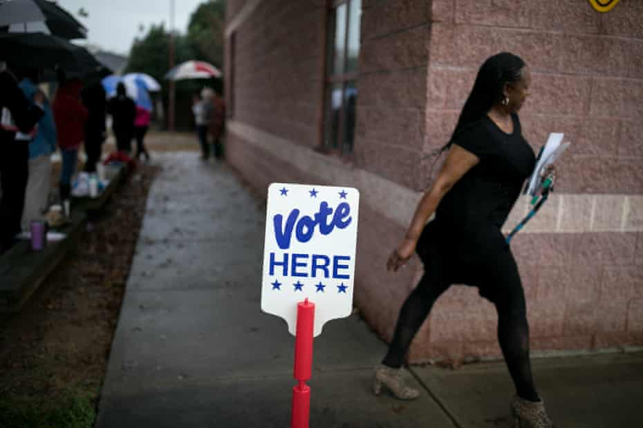 Residents of Charlotte, North Carolina, arrive at a polling station to vote.
