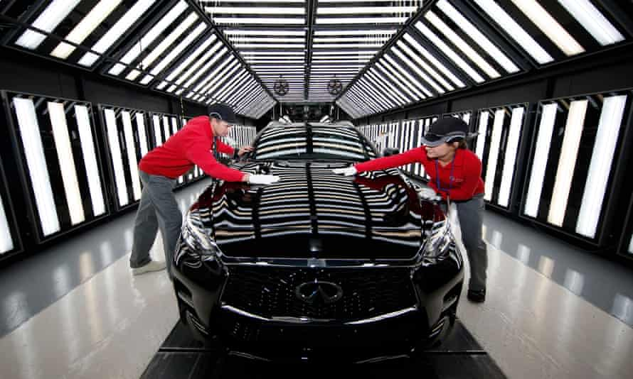 Workers at Nissan's plant in Sunderland on the production line for the Infiniti Q30 'active compact'.