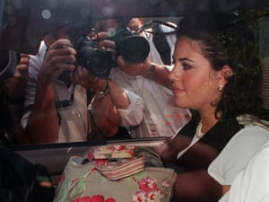 Monica Lewinsky in ca car surrounded by photographers