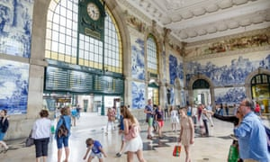 The tiled interior of the recently restored São Bento railway station in Porto, Portugal.