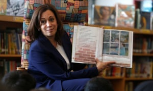 Kamala Harris reads a book about kindness to students at an elementary school in Dearborn, Michigan.