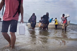 the team from Safari Doctors taking ashore supplies to the people in Kiangwe village, eastern Kenya