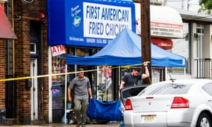 FBI investigators gather evidence at First American Fried Chicken, owned by the family of Ahmad Khan Rahami, in Elizabeth, New Jersey Monday.