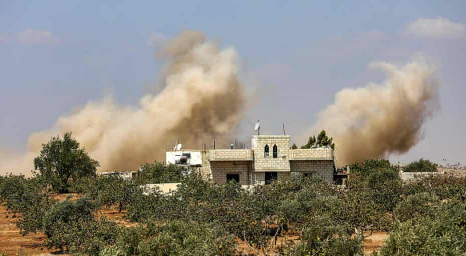 Smoke plumes rising from Syrian government forces' bombardment on the town of Al-Tamanah on the southern edges of the rebel-held Idlib province.