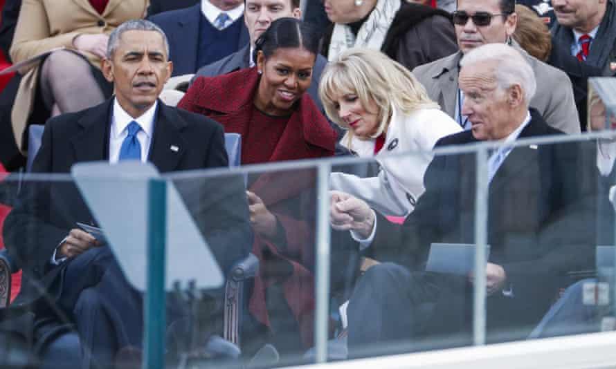 Barack Obama sits with Michelle Obama, Jill Biden and Joe Biden at the inauguration.