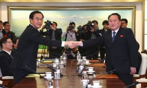 South Korea unification minister Cho Myung-Gyun (left) shakes hands with North Korean chief delegate Ri Son-Gwon at the border truce village of Panmunjom.