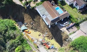 The house was left partially suspended over a sheer drop after a cliff collapse.