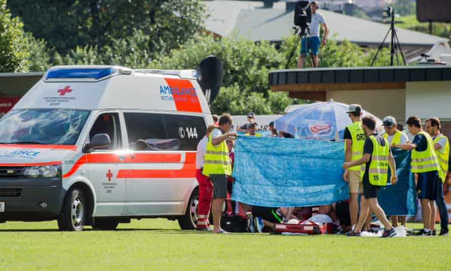 Abdelhak Nouri of Ajax is treated on the pitch.