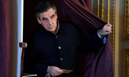 François Fillon leaves the voting booth after casting his ballot in the Republican party's primary election